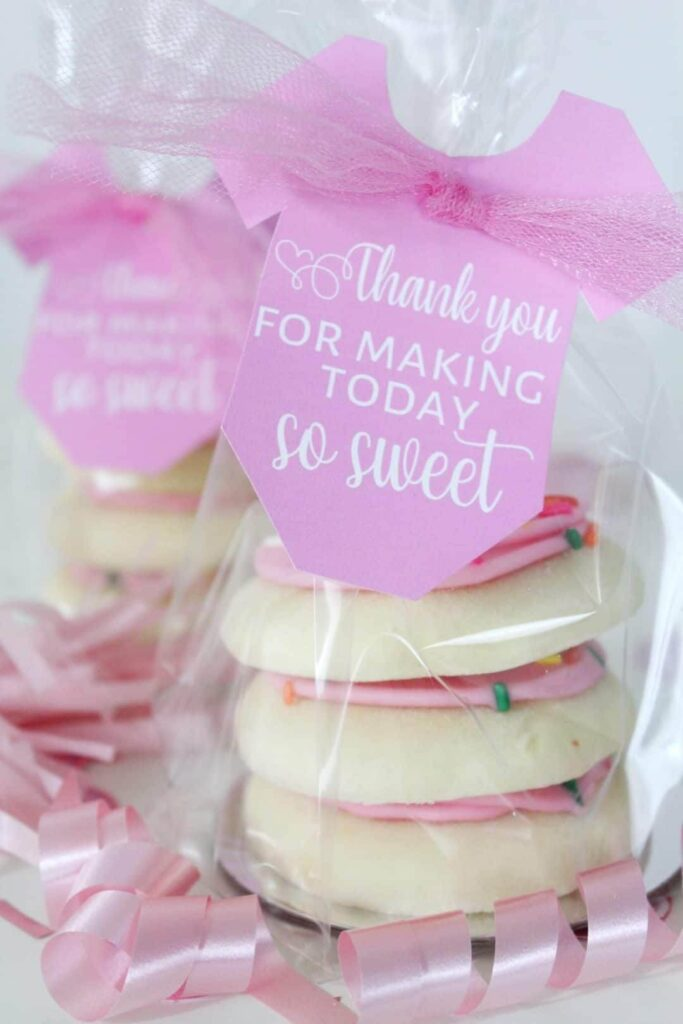 Homemade cookies or treats in a transparent bag with a onesie gift tag